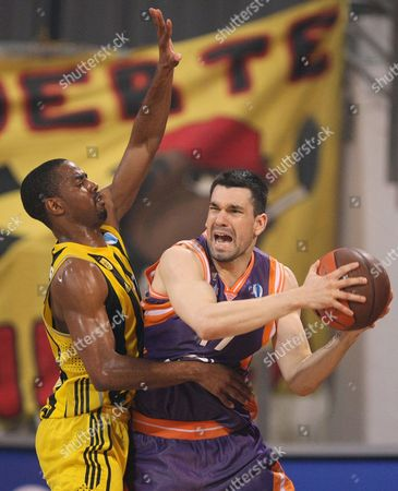Valencias Rafa Martinez (r) Fights For the Ball with Aris Aaron Miles (l) During Their Eurocup Quarter Final Basketball Match at the Alexandreio Melathron Arena in Thessaloniki Greece 24 March 2010 Greece Thessaloniki