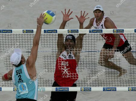 Markus Egger (l) From Switzerland Co-player of Martin Laciga (not in Picture) Competes with Josh Slack (c) and Andrew Scjacht (r) From Australia During Their Semi-final Match at the Swatch -fivb World Tour of Athens Saturday 03 September 2005 Greece Athens