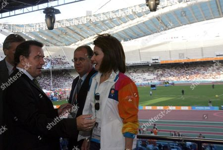 German Chancellor Gerhart Shroeder (l) Chats with Athens 2004 Olympic Games Organizing Committee President Gianna Angelopoulos-daskalaki (r) and Her Husband Theodoros Angelopoulos in the Athens Olympic Complex where He Attended the Athens 2004 Paralympic Games on Saturday 25 September 2004 Greece Athens