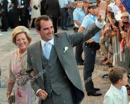 Nikolaos Son of the Former King Constantine of Greece and Anne-marie of Denmark Waves to the Crowd As He Arrives with His Mother Anne-marie of Denmark (l) at Agios Nikolaos Church For Prince Nikolaos Wedding Ceremony with Tatiana Blatnik (unseen) on the Island of Spetses Greece 25 August 2010 the Wedding was Attended by Royals From All Over Europe Including Spain Denmark and Sweden Greece Spetses Island