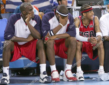 Us Basketball Players Emeka Okafor (l) Amare Stoudemire (c) and Allan Iverson (r) React on the Bench As Their Team is Defeated by Puerto Rico in a Preliminary Group B Basketball Match of the Athens 2004 Olympic Games Sunday 15 August 2004 the Us Team Lost 73-92 Epa/ana/dpa Akis Mikoniatis Greece Athens