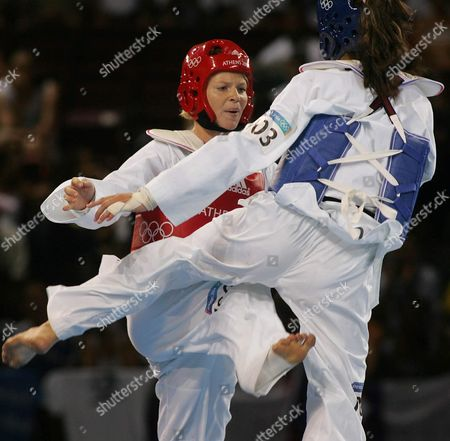 French Myriam Baverel (red) Exchange Kicks with Nadin Dawani of Jordan in the Athens 2004 Olympic Games +67kg Category of the Taekwondo Tournament in the Faliro Olympic Indoor Hall on Sunday 29 August 2004 Greece Athens
