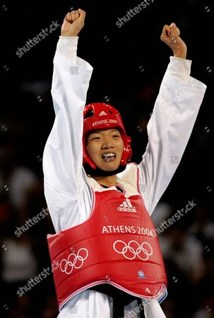 Stock Photo of China's Zhong Chen (rear) Celebrates Her Victory Over France's Myriam Baverel (fnot Pictured) in the Final Bout of the Women's +67 Kg Taekwondo Category of the Athens 2004 Olympic Games Sunday 29 August 2004 Greece Athens