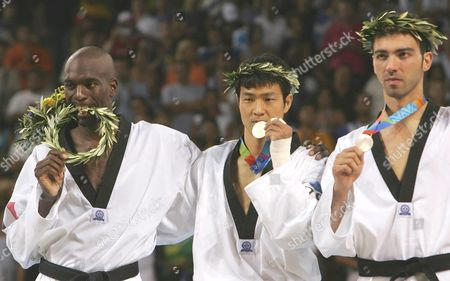 Korean Moon Dae Sung (c) France's Pascal Gentil (l) and Greece's Alexandros Nikolaidis (r) Receive Their Athens 2004 Olympic Games Medals For the +80 Kg Taekwondo Category Sunday 29 August 2004 Moon Dae Sung Won the Gold Pascal Gentil the Bronze and Alexandros Nikolaidis the Silver Medal Epa/ana Paris Papaioannou Greece Athens