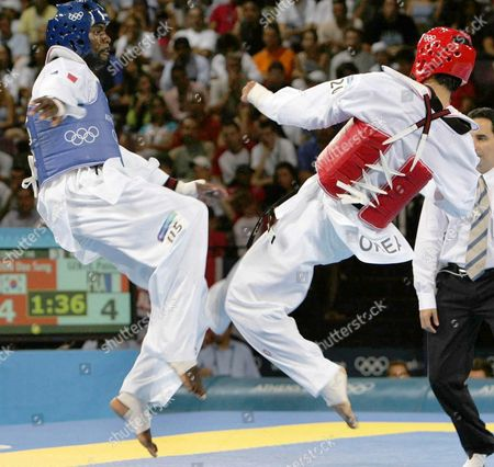 France's Pascal Gentil (l) Exchange Kicks with Korean Sung Dae Moon (r) in the Athens 2004 Olympic Games +80-kilo Taekwondo Category in the Faliro Olympic Indoor Hall on Sunday 29 August 2004 Moon Won 5 to 3 Epa/paris Papaioannou Greece Athens