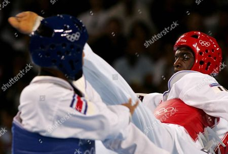 French Pascal Gentil (red) Exchanges Kicks with Kristopher Cabez Moitland of Costa Rica in the Athens 2004 Olympic Games +80kg Category of the Taekwondo Tournament in the Faliro Olympic Indoor Hall on Sunday 29 August 2004 Greece Athens