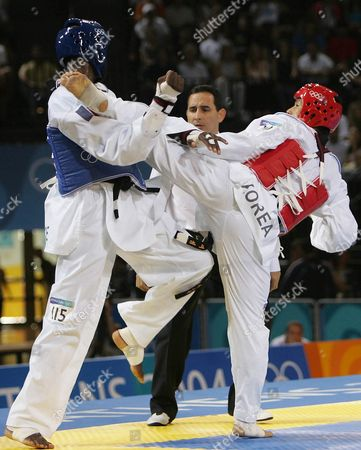 French Pascal Gentil (blue) Exchanges Kicks with South Korean Sung Dae Moon in the Athens 2004 Olympic Games +80kg Category of the Taekwondo Tournament in the Faliro Olympic Indoor Hall on Sunday 29 August 2004 Greece Athens