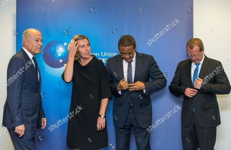 (L-R) Secretary General of the League of Arab States Ahmed Aboul Gheit, European Union (EU) High Representative for foreign policy Federica Mogherini, African Union (AU) High Representative for Libya Jakaya Kikwete and UN Special Representative for Libya Martin Kobler prepare to stand for a group photograph ahead of a meeting at the European Union External Action (EEAS) building in Brussels, Belgium, 23 May 2017. The group will discuss solutions to the Mediterranean refugee crisis and political tensions and security in Libya.