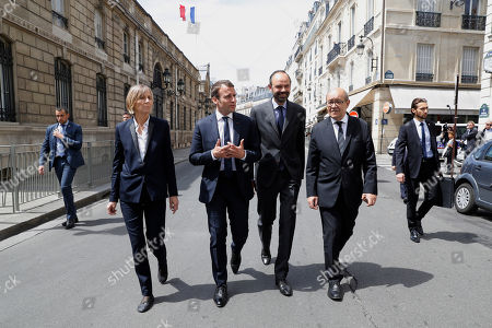 French President Emmanuel Macron, 2nd left, walks towards the British embassy in Paris to present his condolences to the British ambassador to France, Edward Llewellyn, with French Minister for European Affairs Marielle de Sarnez, left, French Prime Minister Edouard Philippe and French Foreign Affairs Minister Jean-Yves Le Drian, right, France, . An apparent suicide bomber attacked an Ariana Grande concert as it ended Monday night, killing over a dozen of people among a panicked crowd of young concertgoers