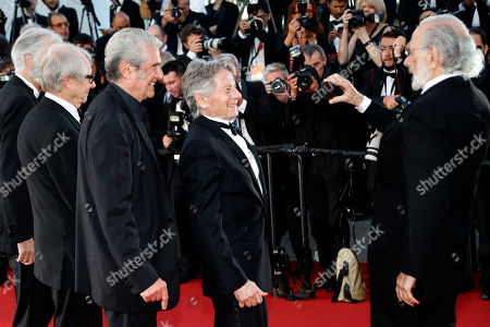 Michael Haneke, Ken Loach, Claude Lelouch, Roman Polanski, Jerry Schatzberg Previous Palme d'or winners from left, Ken Loach, Claude Lelouch, Roman Polanski are filmed by Jerry Schatzberg as they pose for photographers upon arrival at the 70th Anniversary of the film festival, Cannes, southern France