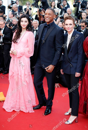 Actors Fan Bing Bing, left, Will Smith, center, and director Maren Ade pose for photographers upon arrival at the 70th Anniversary of the film festival, Cannes, southern France