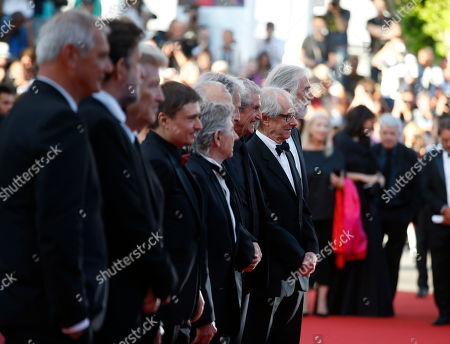 Michael Haneke, Ken Loach, Claude Lelouch Previous former Palme d'or winners Michael Haneke, right, Ken Loach, second from right, and Claude Lelouch, third from right, pose for photographers upon arrival at the 70th anniversary of the film festival, Cannes, southern France