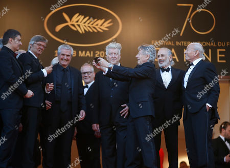 Bille August, Claude Lelouch, David Lynch, Roman Polanski, Jerry Schatzberg, Mohammed Lakhdar-Hamina, Cristian Mungiu Previous former Palme d'or winners from left, Cristian Mungiu, Bille August, Claude Lelouch, David Lynch, Roman Polanski, Jerry Schatzberg and Mohammed Lakhdar-Hamina pose for photographers upon arrival at the 70th anniversary of the film festival, Cannes, southern France