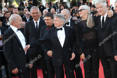 Laurent Cantet, Cristian Mungiu, Roman Polanski, Jane Campion, David Lynch, Mohammed Lakhdar-Hamina Previous former Palme d'or winners from left, Mohammed Lakhdar-Hamina, Laurent Cantet, Cristian Mungiu, Roman Polanski, Jane Campion and David Lynch pose for photographers upon arrival at the 70th anniversary of the film festival, Cannes, southern France