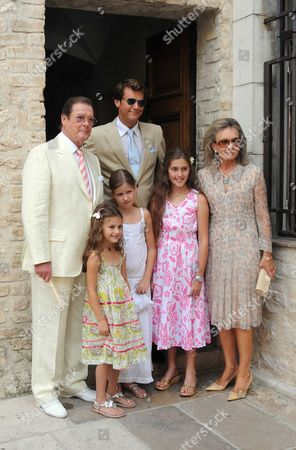 Stock Picture of Son of Sir Roger Moore Christian and his new wife. Sir Roger Moore and his wife Kristina, Kiki, at the wedding Roger's son Christian. the wedding ceremony took place at Saint Paul de Vence town hall. It was followed by a lunch at the famous restarant 'La Colombe', Saint Paul de Vence, FRANCE - 17/07/2009