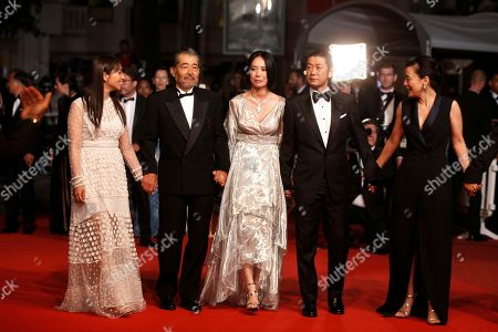 Stock Image of Ayame Misaki, Tatsuya Fuji, Naomi Kawase, Masatoshi Nagase, Misuzu Kanno From left, actors Ayame Misaki, Tatsuya Fuji, director Naomi Kawase, actors Masatoshi Nagase and Misuzu Kanno pose for photographers upon arrival at the screening of the film Hikari at the 70th international film festival, Cannes, southern France