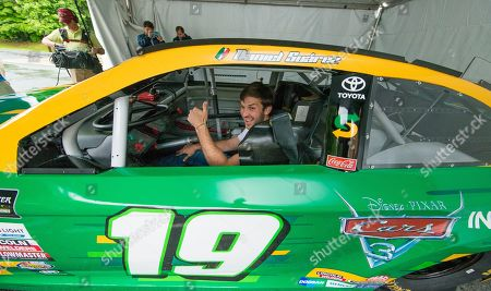 "IMAGE DISTRIBUTED FOR SUBWAY - Subway® ambassador and Joe Gibbs Racing driver Daniel Suárez fires up the engine of his custom branded Subway/Cars 3 stock car for children at the Salvation Army Boys & Girls Club of Greater Charlotte, at a special after school event celebrating the upcoming release of ""Disney?Pixar's Cars 3."" Featuring the voices of Owen Wilson, Cristela Alonzo, Armie Hammer and Daniel Suárez, ""Cars 3"" cruises into theaters on June 16, 2017 in 3D"