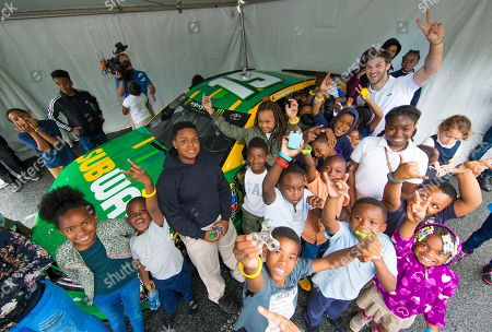 "IMAGE DISTRIBUTED FOR SUBWAY - Subway® ambassador and Joe Gibbs Racing driver Daniel Suárez shows off his custom branded Subway/Cars 3 stock car for children at the Salvation Army Boys & Girls Club of Greater Charlotte, at a special after school event celebrating the upcoming release of ""Disney?Pixar's Cars 3."" Featuring the voices of Owen Wilson, Cristela Alonzo, Armie Hammer and Daniel Suárez, ""Cars 3"" cruises into theaters on June 16, 2017 in 3D"