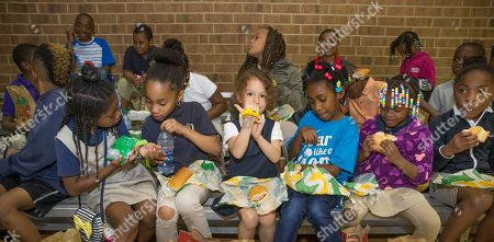 "IMAGE DISTRIBUTED FOR SUBWAY - Children from the Salvation Army Boys & Girls Club of Greater Charlotte model their Subway/Cars 3 digital watches (free with the purchase of a Subway kids meal, starting June 5, 2017) and enjoy Subway sandwiches, in Charlotte, NC, at a special after-school event celebrating the upcoming release of ""Disney?Pixar's Cars 3."" Featuring the voices of Owen Wilson, Cristela Alonzo, Armie Hammer and Daniel Suárez, ""Cars 3"" cruises into theaters on June 16, 2017 in 3D"