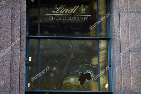 A view of broken windows at the Lindt Cafe in Sydney, New South Wales (NSW), Australia, 03 June 2015 (issued 24 May 2017). NSW Coroner Michael Barnes found on 24 May 2017, that gunman Man Haron Monis, who held 18 people hostage inside a Lindt cafe in Sydney in December 2014, was the solely responsible for the deaths and injuries during the Lindt Cafe siege, adding that authorities made major errors in the operation before a hostage was killed.