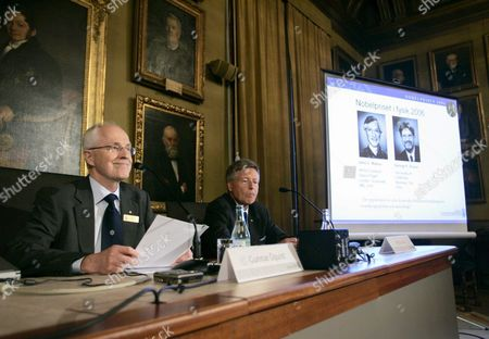 Gunnar ?quist Permanent Secretary of the Royal Academy of Sience and Per Carlson Chairman of the Nobel Committ?e Announced the Nobel Prizewinners in Physics the American Sientists John Mather and George Smoot Will Share the Prize Sweden Stockholm