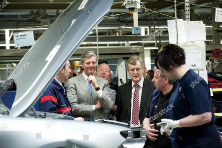 Spykers Cars Chief Executive Victor R Muller (left) and Saab's Chief Executive Jan Ake Jonsson (third From Right) Watch Over Production Line Activity at Saab's Factory in Trolhattan Sweden 22 March 2010 As Production Resumes at Swedish Carmaker Saab's Main Plant Dutch-based Niche Group Spyker Cars Took Over of Saab As Owner From Us Giant General Motors Sweden Trollh?ttan