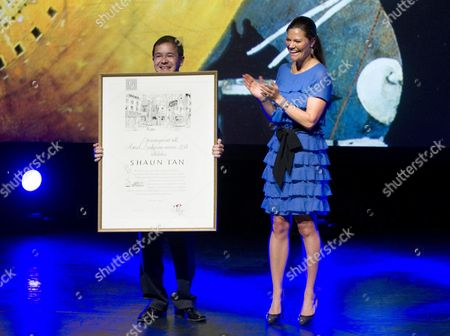 Stock Photo of Australian Child Book Illustrator Shaun Tan (l) Holds Up the Astrid Lindgren Memorial Award After Receiving It From Swedish Crown Princess Victoria (r) During a Ceremony at the Stockholm Concert Hall in Sweden 31 May 2011 the Award is a Childrens Literature Award That Exists Since 2002 Sweden Stockholm