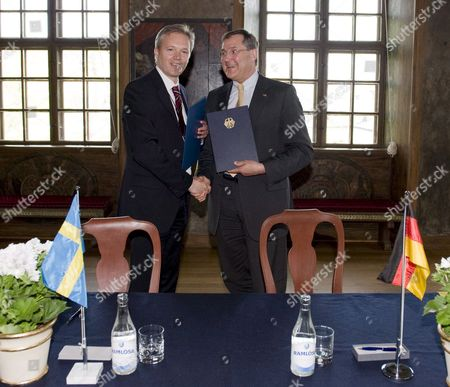 Swedish Minister of Defense Sten Tolgfors (l) and His German Counterpart Franz Josef Jung (r) Shake Hands After Signing a Bilateral Research Development Production and Acquisition Memorandum of Understanding in the Defense Area at the Karlberg Castle in Stockholm Sweden April 28 2009 Sweden Stockholm