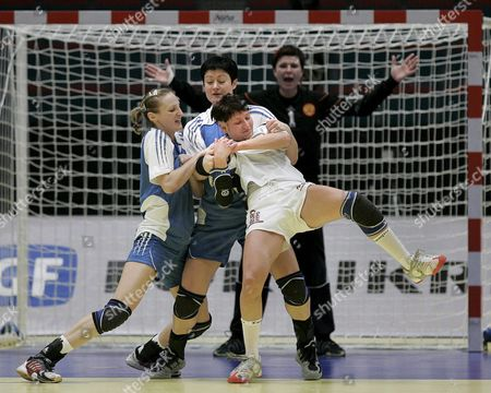 Russian Defenders Ekatarina Andryushina (l) and Oxana Poltoratskaya (c) Block Germany's Anja Althaus (foreground) in Front of Russian Goalie Inna Suslina (r) in Their Euro 2006 Handball Semifinal in Stockholm Sweden 16 December 2006 Russia Won 33-29 and Plays in the Final Sunday Sweden Stockholm