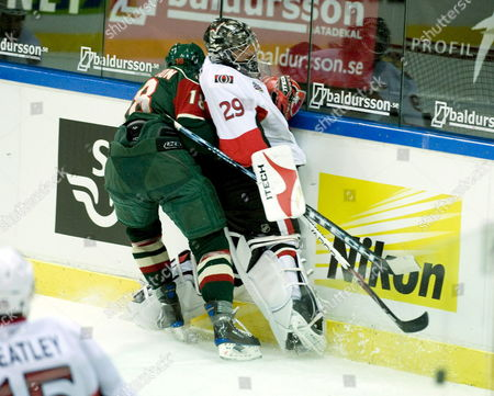 Stock Picture of Frolunda's Andreas Carlsson (l) Tackles Goalkeeper Martin Gerber in the Friendly Ice-hockey Match Between Frolunda Hc and Ottawa Senators at the Scandinavium Arena in Gothenburg Sweden on 02 October 2008 Sweden Gothenburg