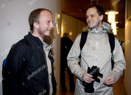 Pirate Bay Founders Gottfrid Svartholm Warg (l) and Peter Sunde (r) Arrive For Their Trial at Stockholm's City Court Sweden on 16 February 2009 the Defendants Are Accused of Breaking Swedish Copyright Law by Helping Internet Users Worldwide Download Protected Music Movies and Computer Games Sweden Stockholm