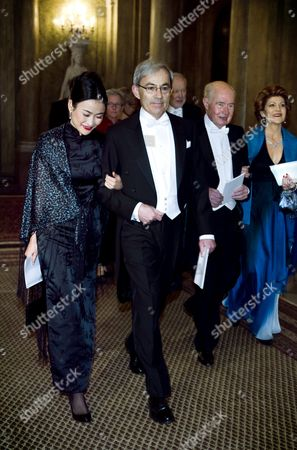 Stock Image of Li Wa Ngai and Christopher a Pissarides Laureate in Economic Sciences Arriveat the King's Dinner For the Nobel Laureates at the Royal Palace in Stockholm Sweden 11 December 2010 Sweden Stockholm