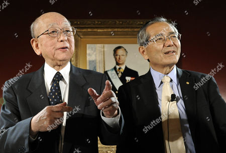 Nobel Chemistry Laureates Akira Suzuki (l) of Japan and His Compatriot Ei-ichi Negishi (r) Address to Media During a Press Conference at the Grand Hotel in Stockholm Sweden 09 December 2010 the Two Scientists Will Receive the Nobel Prize in Chemistry 2010 During the Ceremony on 10 December the Portrait in Background Shows King Carl Xvi Gustaf of Sweden who Will Hand Over the Prizes Sweden Stockholm