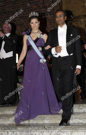 Sweden's Crown Princess Victoria (l) Arrives with Nobel Prize in Chemistry Laureate Professor Venkatraman Ramakrishnan (r) For the Nobel Banquet at the Stockholm Town Hall Sweden 10 December 2009 the Nobel Prizes Were Handed out by the Swedish King During a Ceremony at the Stockholm Concert Hall Earlier the Same Day Sweden Stockholm