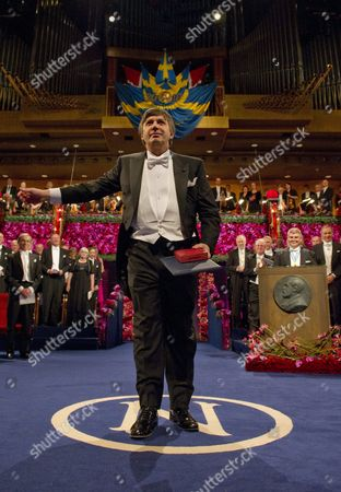 Dutch Andre Geim Bows After Receiving the Nobel Prize in Physics From the Swedish King at the Concert Hall in Stockholm Sweden 10 December 2010 Professor Geim is Affiliated to University of Manchester Manchester United Kingdom; He is a Dutch Citizen Born in Russia Sweden Stockholm