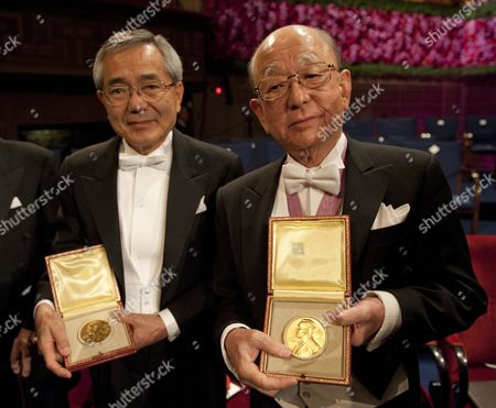 Japanese Compatriots Ei-ichi Negishi (l) and Akira Suzuki (r) Display Their Nobel Medals After Receiving Them From the Swedish King at the Concert Hall in Stockholm Sweden 10 December 2010 Professor Ei-ichi is Affiliated to Purdue University West Lafayette Usa and Professor Suzukii is Affiliated to Hokkaido University Sapporo Japan Sweden Stockholm