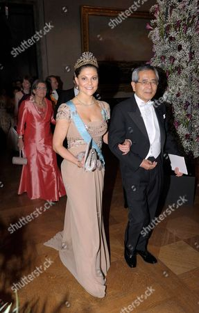 Stock Image of Sweden's Crown Princess Victoria (l) is Escorted by Nobel Chemistry Laureate Ei-ichi Negishi (r) to the Prince's Gallery During the Nobel Banquet in the Stockholm Town Hall Sweden 10 December 2010 Professor Negishi is a Japanese Citizen Born in China Affiliated to Purdue University West Lafayette Indiana Usa Sweden Stockholm