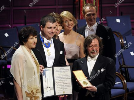 Stock Picture of Konstantin Novoselov (2-l) Displays His Diploma and Medal Together with Family and Friends After Receiving the Shared Nobel Prize in Physics From the Swedish King at the Concert Hall in Stockholm Sweden 10 December 2010 Doctor Novoselov is Affiliated to the University of Manchester United Kingdom; He is a Russian and British Citizen Sweden Stockholm