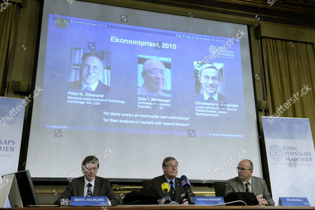 Stock Photo of (l-r) Professor Bertil Holmlund; Permanent Secretary of the Royal Academy of Sciences Staffan Normark and Professor Per Krusell Announce That the Nobel Prize in Economic Sciences 2010 is Awarded Jointly to (portraits on Overhead Screen From Left) Us Researchers Peter a Diamond and Dale T Mortensen and British-cypriot Citizen Christopher a Pissarides in Stockholm Sweden 11 October 2010 the Trio Were Awarded the Prize For Their 'Analysis of Markets with Search Frictions ' in Relation to the Labour Market Sweden Stockholm