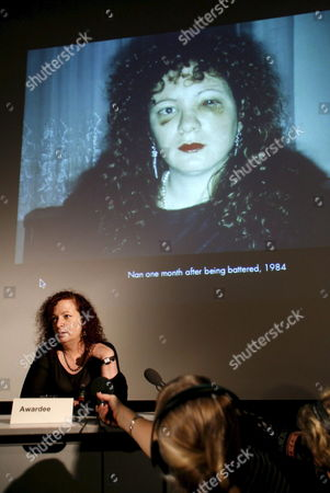 U S Photographer Nan Goldin Sits Under a Projection of One of Her Own Photos During a Press Conference at the Hasselblad Foundation in Gothenburg Sweden Thursday 08 March 2007 Goldin was Awarded with the 2007 Hasselblad Award in Photography From the Ciltation: She Has Been Documenting Her Own Life and That of Her Friends - Her Extended Family - For More Than 30 Years Focusing on the Urban Scene in New York and Europe in the 1970s 80s and 90s Marked So Dramatically by Hiv and Aids Sweden Gothenburg