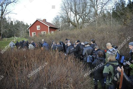 Stock Photo of Media March Single File Through the Brush to a Hunting Lodge in the Woods of Hunneberg South West Sweden 04 November 2010 to Attend a Press Conference Held by King Carl Gustaf of Sweden Currently Hunting Elk About a Book Entitled 'Carl Xvi Gustaf the Unwilling Monarch' the Controversial Book by Thomas Sjoeberg Reportedly Provides a Rare and Detailed Look Into the King's Private Life Including Details of Love Affairs Wild Parties with Swedish Models and Connections to the Underworld Sweden Hunneberg