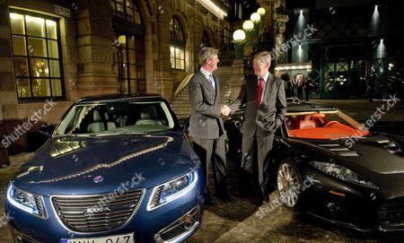Victor Muller (l) Chairman of Spyker Cars Shake Hands with Saab Automobile Ceo Jan-ake Jonsson Standing in Between a Saab and a Spyker Car Outside Cafe Opera in Stockholm Sweden on 26 January 2010 After a Press Conference About Spyker's Acquisition of Saab From G M the Swedish Government Has Also Agreed to Guarantee a 400 Million Euro Loan Saab Had Requested From the European Investment Bank Which was Seen As Key to the Sale Sweden Stockholm