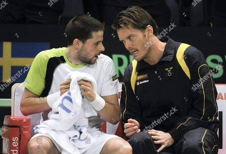 Sweden's Davis Cup Captain Thomas Enqvist Right Talks to Tennis Player Andreas Vinciguerra Left During the Fourth Singles Match Against Argentina's David Nalbandian of Their First Round Davis Cup Tennis Match in Stockholm Sweden 07 March 2010 Sweden Stockholm