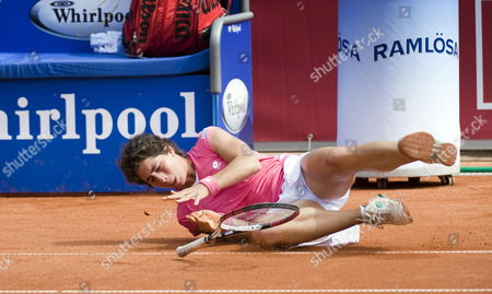 Carla Suarez Navarro of Spain Falls to the Ground During the Quarter Final Match Against Compatriot Maria Jose Martinez Sanchez at the Swedish Open Women's Wta Tennis Tournament in Bastad Sweden 09 July 2009 Sweden Bastad