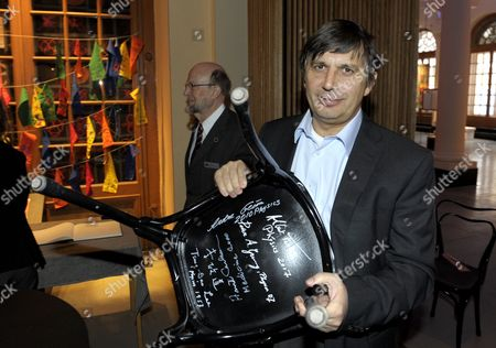 The 2010 Nobel Physics Co-laureate Andre Geim of University of Manchester Manchester United Kingdom Signs a Chair at the Nobel Museum in Stockholm Sweden 06 December 2010 This is One of the Traditions During the Week Leading Up to the Nobel Prize Ceremony That Will Take Place in Stochkolm on 10 December Sweden Stockholm