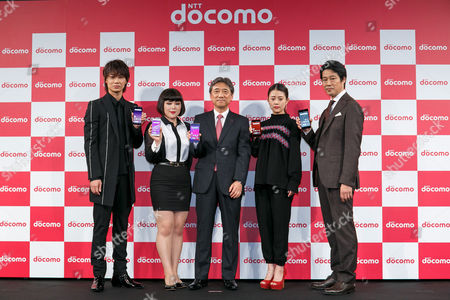 Actors Go Ayano, Buruzon Chiemi, NTT DOCOMO President Kazuhiro Yoshizawa, actress Mitsuki Takahata and actor Shinichi Tsutsumi, pose for cameras during the launch event for 8 new mobile devices for the summer lineup