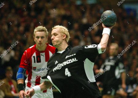 Stock Image of Thw Kiel's Johan Petersson Scores a Goal Against Aalborg During Their Second Leg Quarterfinal in the Handball Ehf Cup Sunday 22 February 2004 in Aalborg Northern Jutland in Background Aalborg's Hovart Tvedten Denmark Aalborg