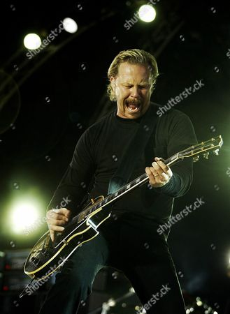 Stock Photo of James Hatfield of the Heavy Metal Group 'Metallica' Performs on Stage at the 'Orange Scene' on the Opening Day of the 33 Roskilde Festival 2003 Thursday 26 June 2003 Epa Photo/scanpix Nordfoto/carl Redhead Denmark Roskiled