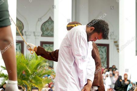 Two homosexual men were sentenced to 82 whips by the Shariah Court in Timur Yunusov Aceh.