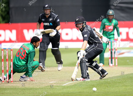 Bangladesh vs New Zealand. New Zealand's Tom Latham with Bangladesh's Nasir Hossain